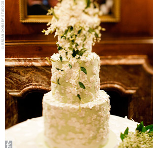 Chelseas wedding dress and bouquet inspired the design of the cake, right down to the lace-like appliqu&#233;s and the lilies of the valley on top.