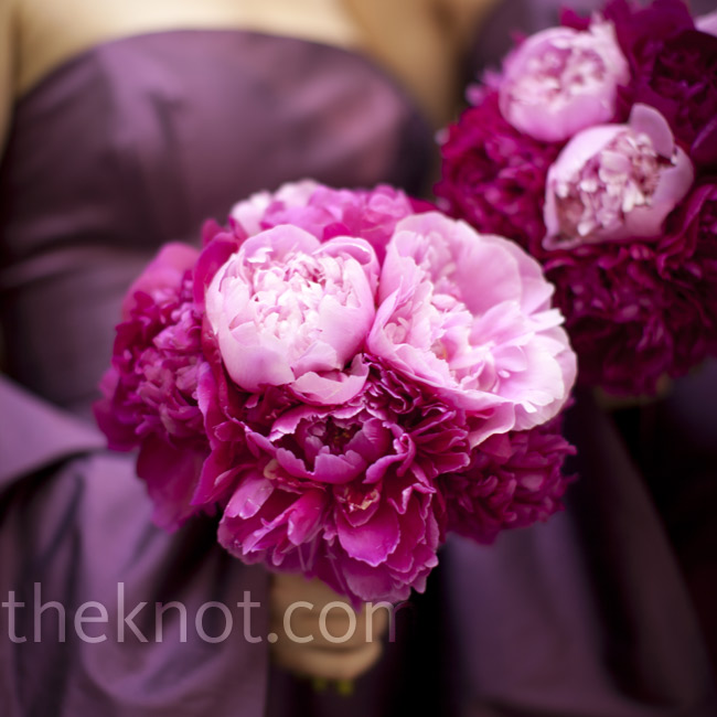 The bridesmaids held hand-gathered bunches of peonies in shades of pink.