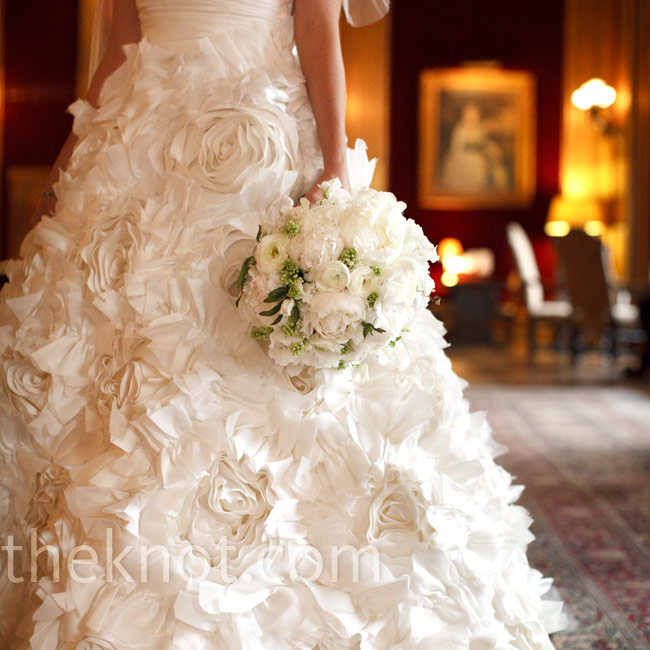 Erin chose a dramatic ivory silk organza ball gown with big silk flowers covering the full skirt.
