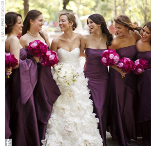 All eight bridesmaids wore strapless plum-colored dresses for a formal look.