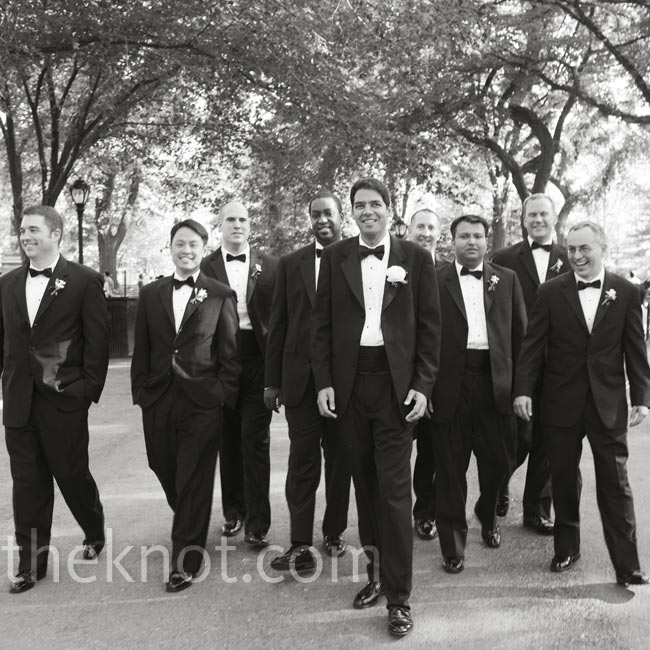 The guys looked sharp in black tuxes with classic black bow ties.