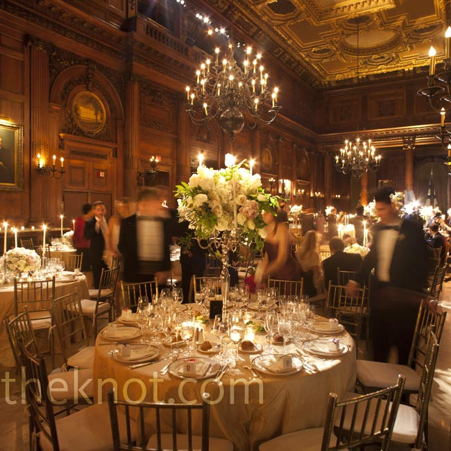 Candelabras, chandeliers and warm uplighting set a romantic mood at the reception.