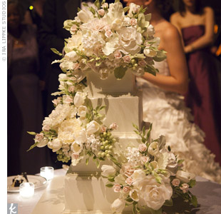 Intricate sugar flowers cascaded down the square cake, mimicking the silk blooms on Erin's gown.