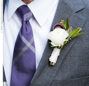 White ranunculus boutonnieres added a classic touch to the groomsmen's modern gray suits and purple plaid ties.