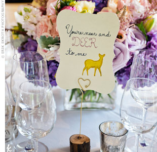 Fun table names, each a clever play on words using animals, complemented the wedding's barn setting.