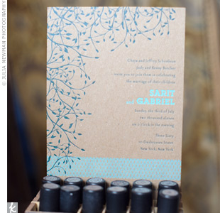 The couples letterpress invitations were printed on kraft paper with teal and light blue inks. The design had an organic vine along one side and a geometric motif framing the bottom to create a unique look.