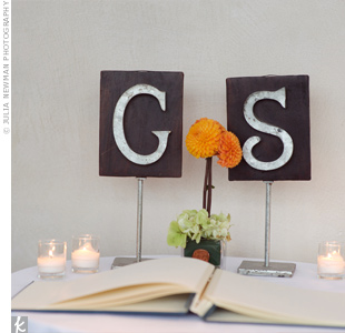 Bright orange dahlias and the couples initials called attention to the guest book table.