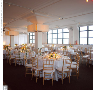 Simple white linens in the venues open space provided a backdrop for the vibrant centerpieces.