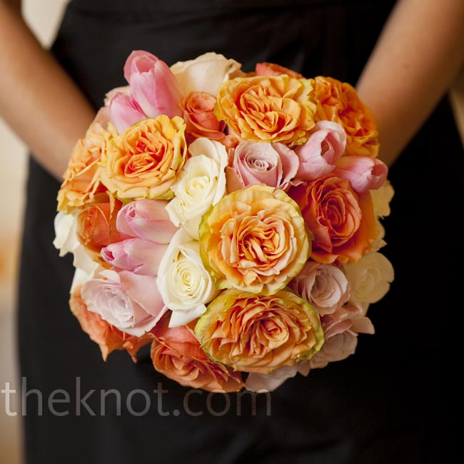 The girls carried bright, rounded bouquets of roses, open garden roses and tulips.