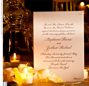 The couple's custom-made invitations were printed in a formal, rich-gold font on ivory-colored linen paper.