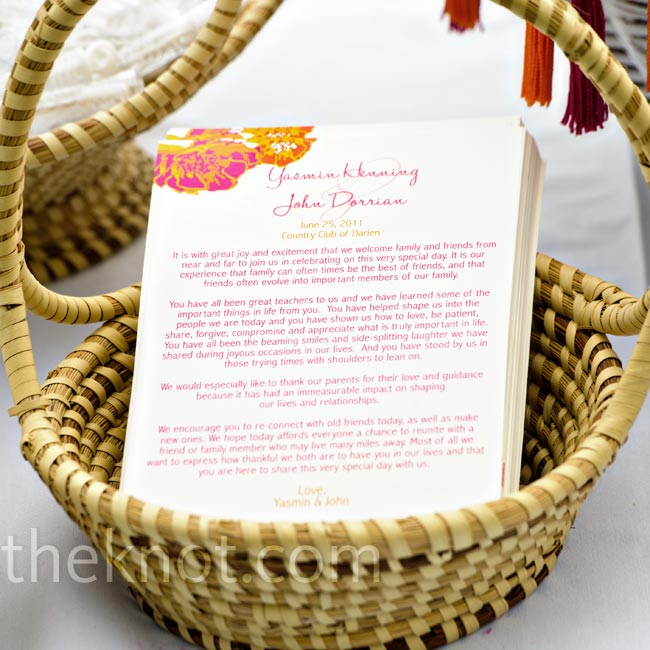A pink and orange marigold design decorated the corner of the ceremony programs.