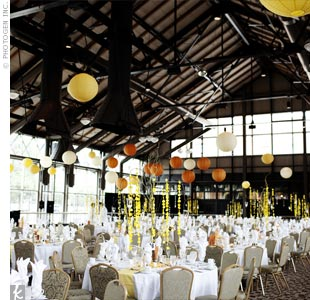 The industrial vibe of The Depot was brightened up with paper lanterns and white table linens. Centerpieces of varying heights decorated the tables.