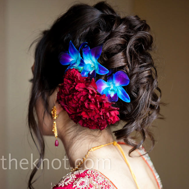 Shazia accented her curly updo with a floral hairpin made of blue orchids 