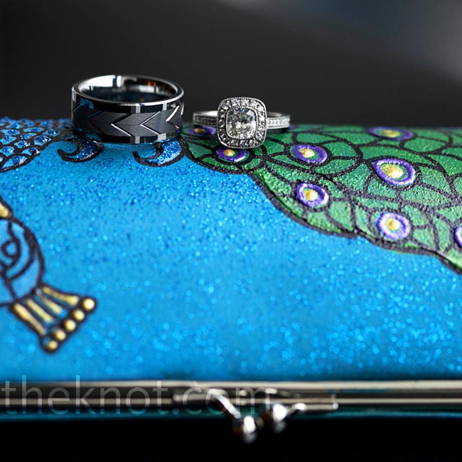 The couple's gorgeous rings stood out against Shazia's hand-painted peacock clutch.