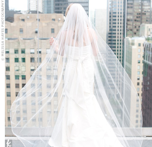 Jennifers floor-length veil looked gorgeous catching the wind on the rooftop.