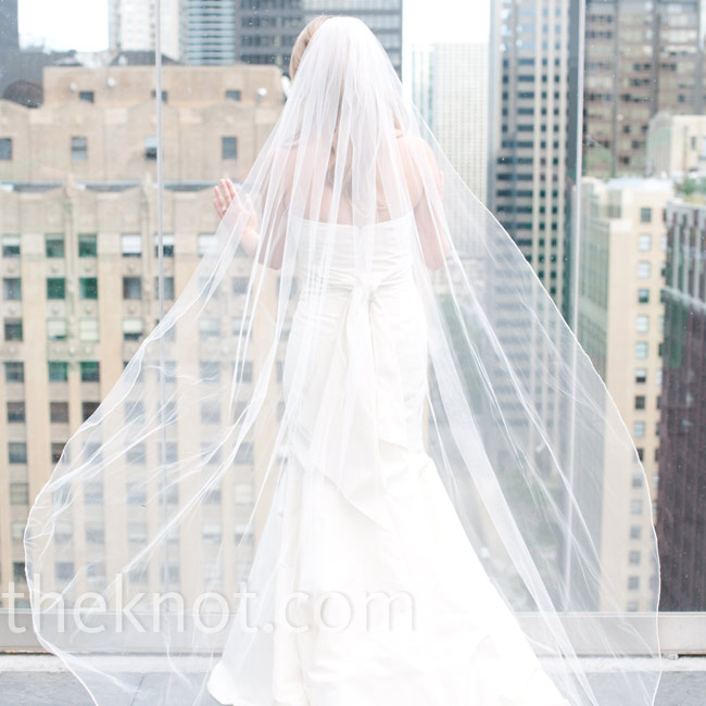 Jennifer's floor-length veil looked gorgeous catching the wind on the rooftop.