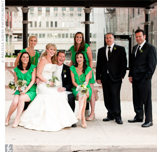 The bridesmaids, wearing ruffled kelly green dresses, stood out against the black-and-white attire of the groomsmen.