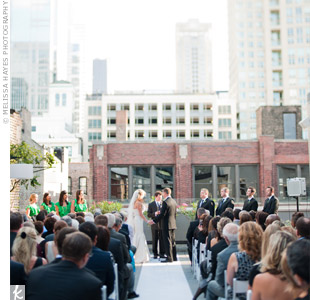 The couple exchanged vows on the restaurants rooftop, keeping the d&#233;cor simple. The skyline was all that was needed, Jennifer says.