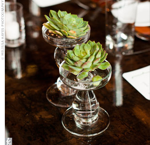 Jennifer loved the reclaimed-wood tables at Epic, so she and Eric kept the tabletops minimal, with only a few votives and single succulents in glass pedestals.