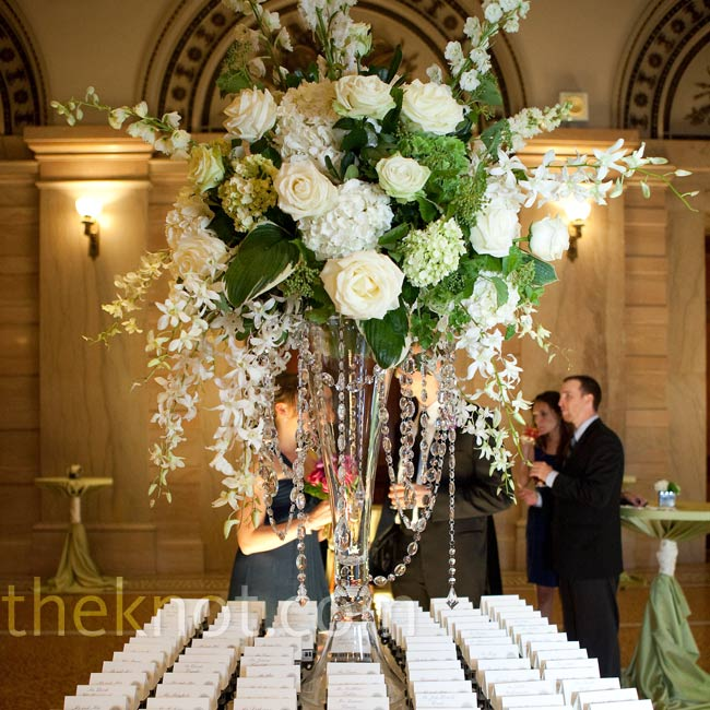 A soaring white floral arrangement marked 