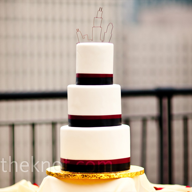 Red and black ribbons trimmed each tier for a modern, masculine look.