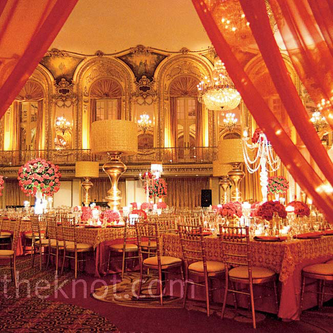 A red and gold palette accented with crystals and candles transformed the hall into a French palace.