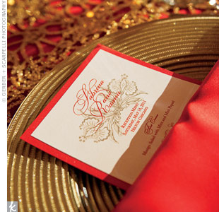 The menu cards were designed to match the red napkins and gold chargers at each place setting.