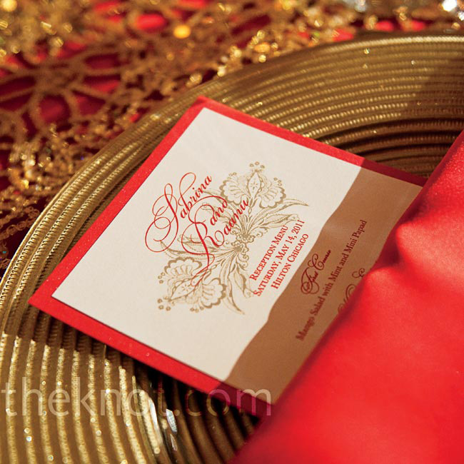 The menu cards were designed to match the red napkins and gold chargers 