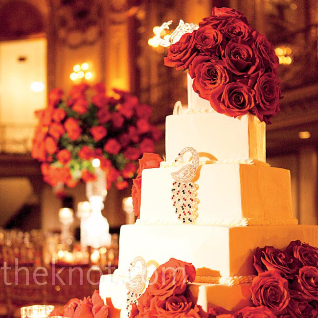 In keeping with the theme, crystal peacocks and 100 red roses adorned the 