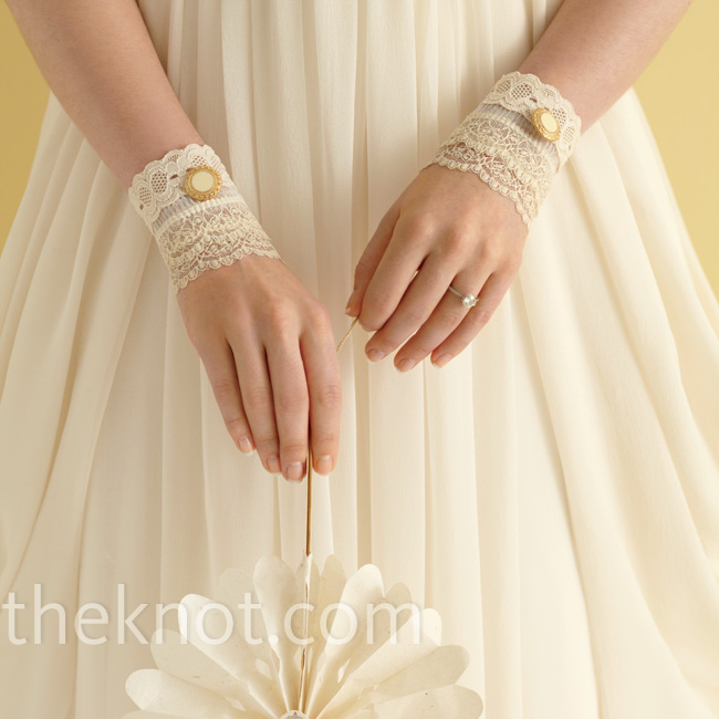 Instead of jewels and baubles, accessorize your wedding dress with these Victorian-style lace cuffs.  Cuffs by My Secret Face, Etsy.com; paper fan, BHLDN.com