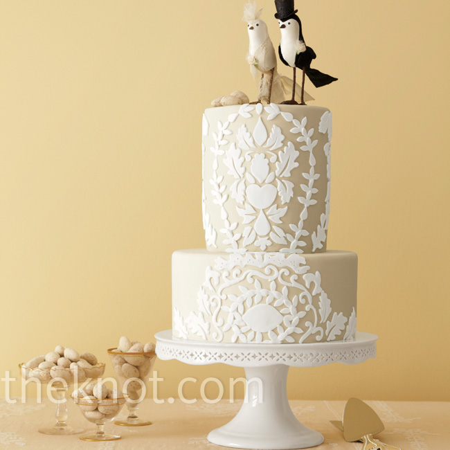 This petite two-tiered cake is covered in lace-like fondant cutouts.   Cake by Vanilla Bake Shop, VanillaBakeShop.com; cake topper, BHLDN.com