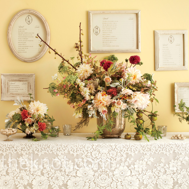 As guests enter the reception, a grand escort card wall takes center stage. The intricate lace tablecloth dresses up a collection of shabby-chic frames displaying guests' seating arrangements.  Escort prints by Regas NY, RegasNY.com; flowers by Saipua, Saipua.com