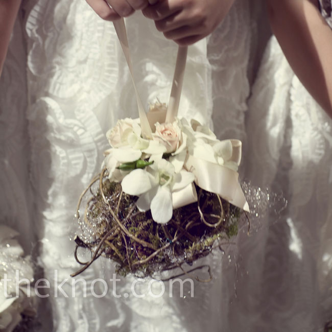 The four flower girls carried pomanders of reindeer moss, silver angel hair, orchids and spray roses.