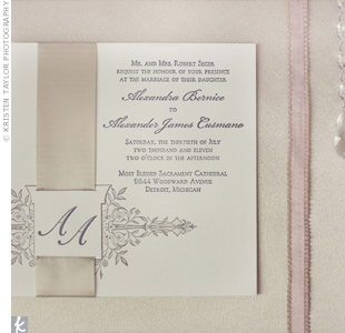 A muted gold ribbon softened the modern, square invitations.