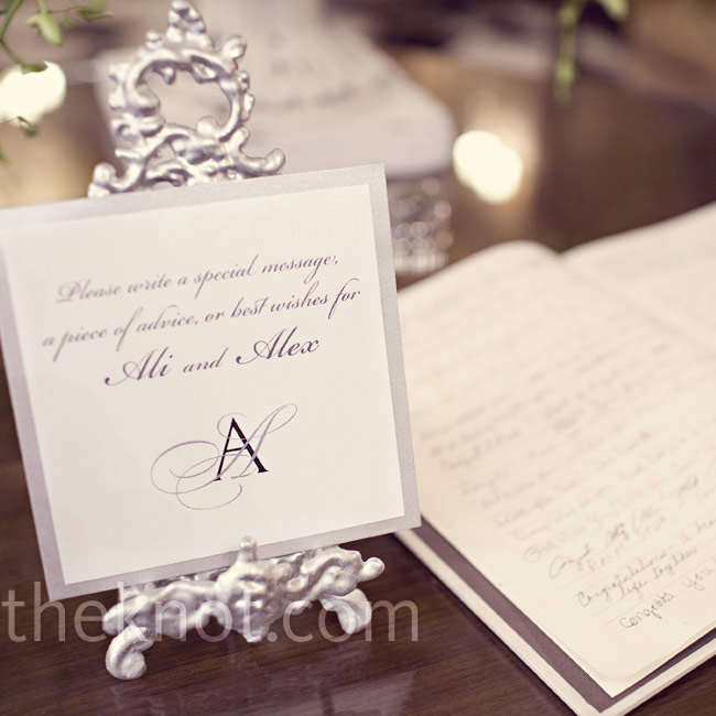 A scripted card set on an ornate silver stand drew attention to the guest book.