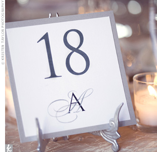 The minimalistic table numbers were displayed in silver winged easels for an elegant touch.