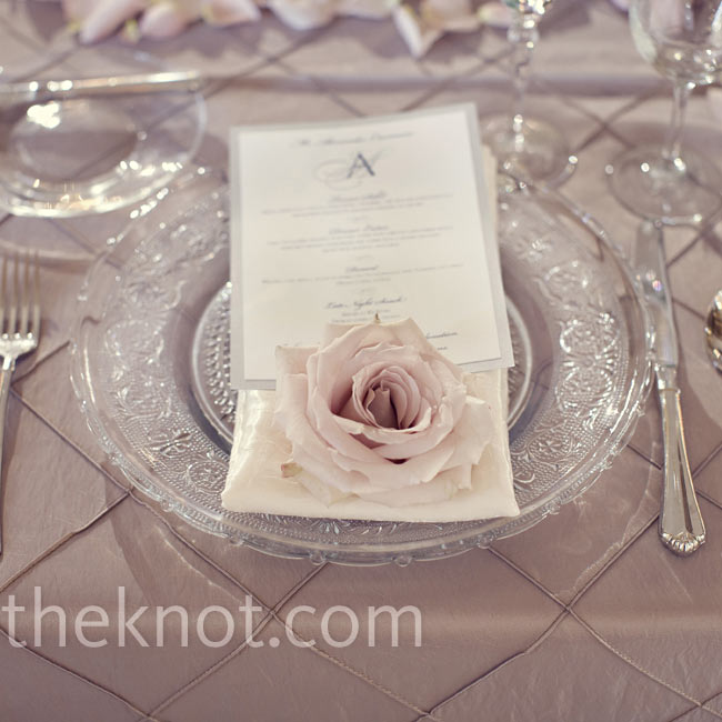 A single rose blossom accented the modern menu cards and ornate chargers.