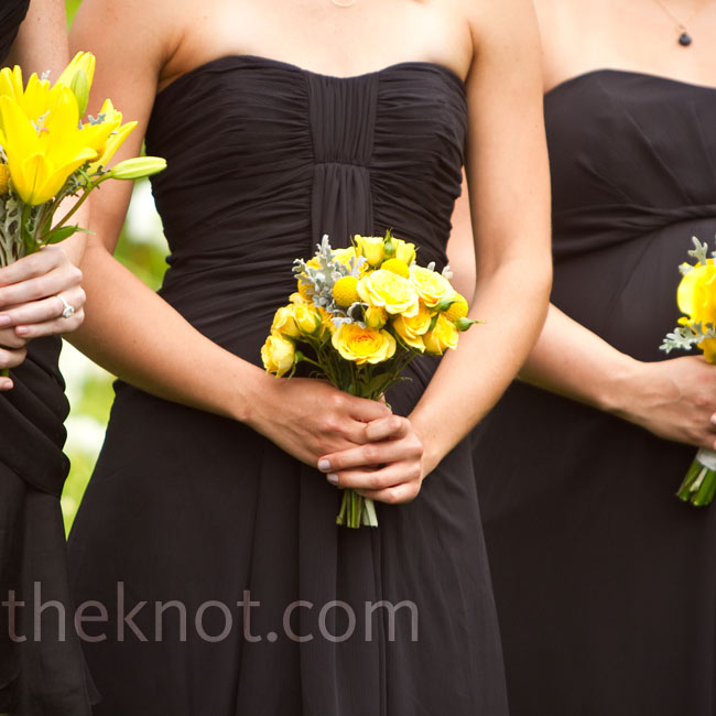 Each bridesmaid wore a black dress of her choosing and carried a slightly different arrangement of cheery yellow flowers.