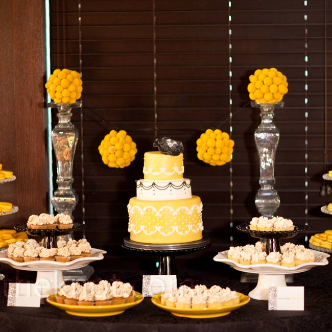 Both the cake and half of the surrounding trays of cupcakes were flavored with lemon raspberry-a sweet nod to the color theme.