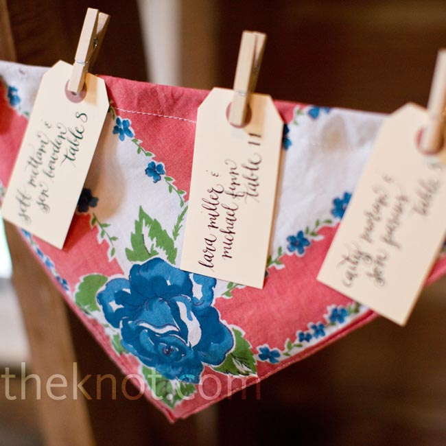 The calligraphed tags hung from clothespins against vintage handkerchiefs.