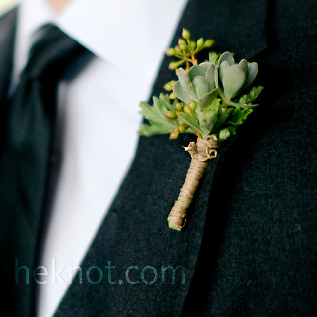 Succulents, seeded eucalyptus, and geranium leaves added a fresh touch to the groomsmen's lapels.