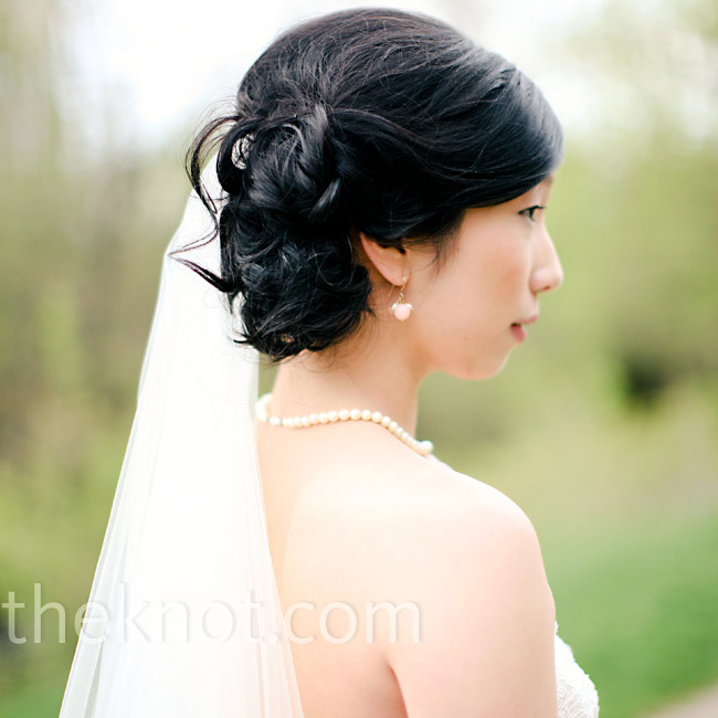 Keeping with the organic feel of the rest of the wedding, Holy went with a loose, off-center chignon and natural makeup with just a hint of color.