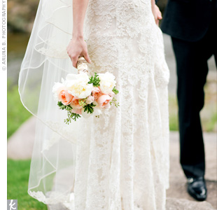 Holly paired her strapless lace sheath gown with a two-tiered ivory veil for a classic, airy look.