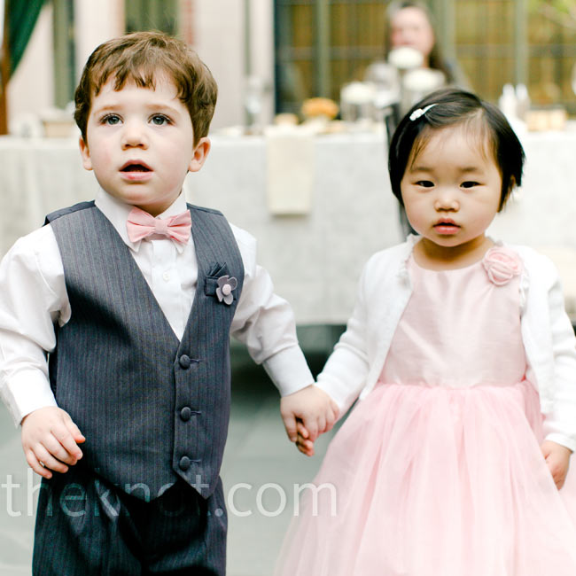 The son of the couple's friends and the daughter of the bride's cousin served as ring bearer and flower girl. But rather than tossing rose petals down the aisle, the duo was pulled in a red wagon, decorated with flowers and greenery.