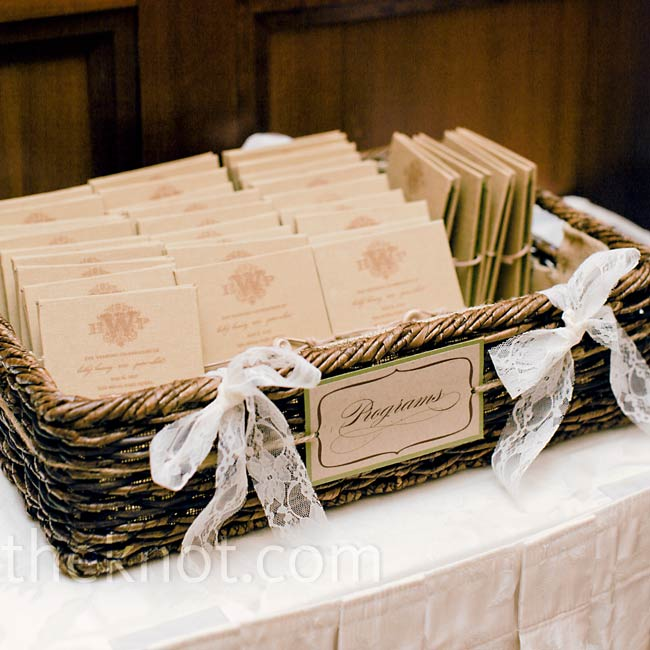 Although Holly designed the ceremony programs, the production was Peter's labor of love. He assembled the cloth book covers and accordion-panel interiors before fastening them with leather and button closures.