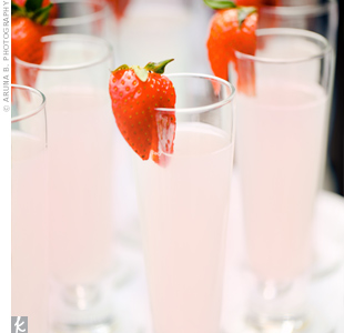 Refreshing glasses of strawberry lemonade fit right in with the wedding's romantic style and garden setting.