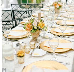 Low centerpieces in rustic vessels, along with votive candles and gold chargers, accented the tables without overshadowing the views from the glassed-in venue.