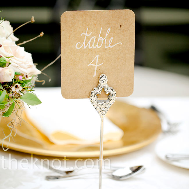 The DIY-loving couple only needed cover-weight cardstock and a white paint marker to make the simple yet elegant table numbers.