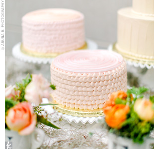 Rather than separating different flavors within the tiers of one cake, the couple opted for three buttercream cakes in different flavors.