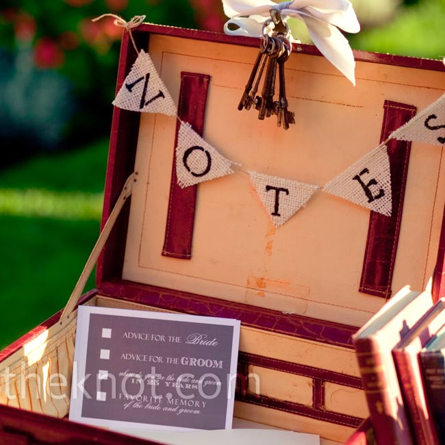For an update on the standard guest book, the couple set out a typewriter next to postcards displayed in an antique suitcase, so guests could type their advice, memories, and predictions for the couple.